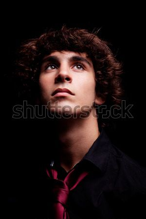 Stock photo: young man looking up