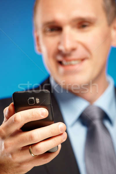 Stock photo: Business man using his mobile phone