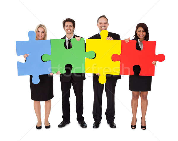 http://stockfresh.com/files/a/andreypopov/m/32/2135735_stock-photo-group-of-business-people-assembling-puzzle.jpg