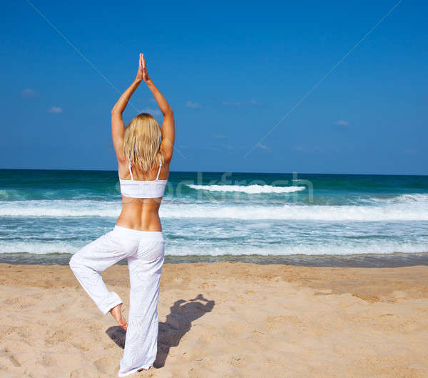 Stock photo: Healthy yoga exercise on the beach