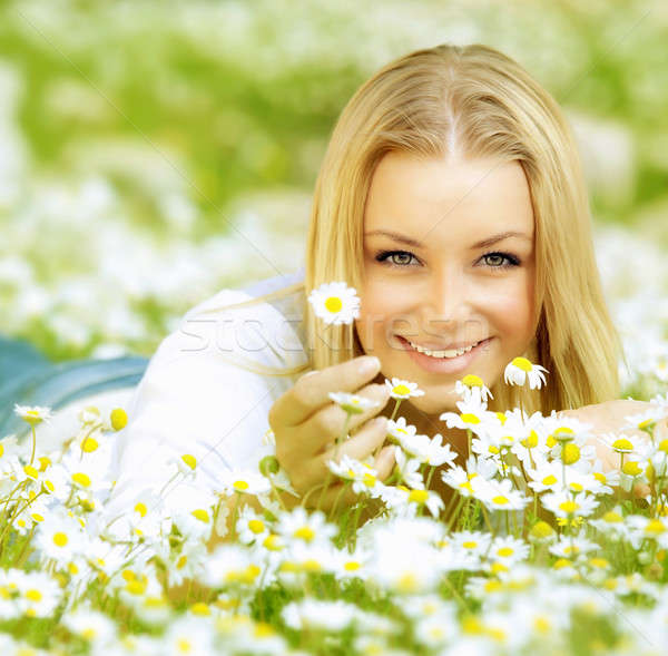 Stock photo: Beautiful girl enjoying daisy field