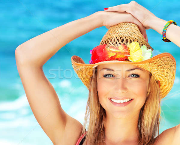 Stock photo: Happy young woman on the beach