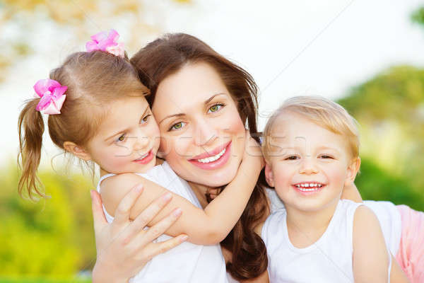 Stock photo: Mother with two kids