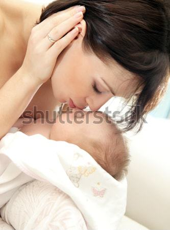 Stock photo: Happy mother with a baby