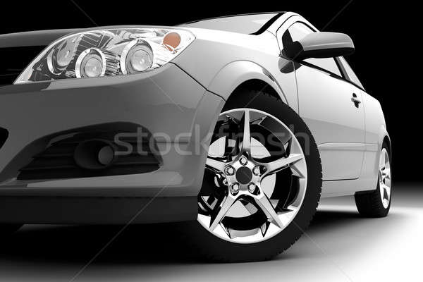 Stock photo: Car front bumper, light and wheel on black