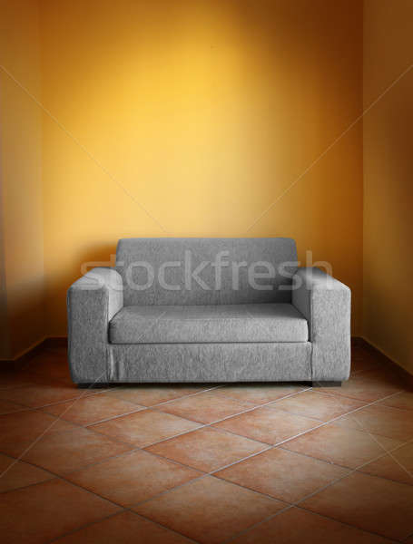 Stock photo: Gray sofa yellow wall