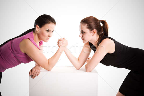 Stock photo: Two businesswomen arm wrestling