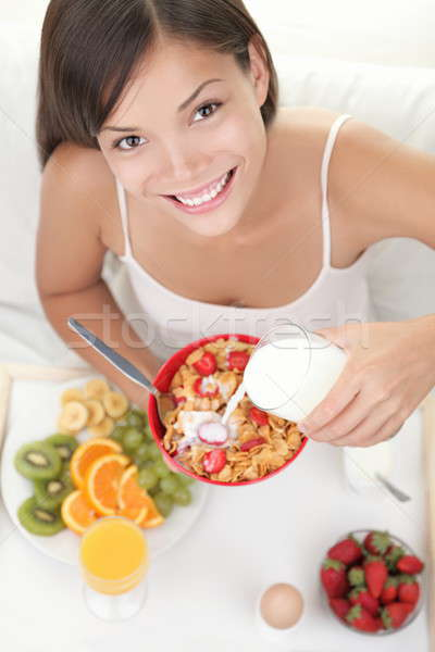 Stock photo: Woman eating breakfast in bed