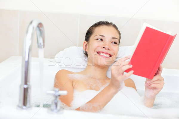 Stock photo: Woman reading book in bath