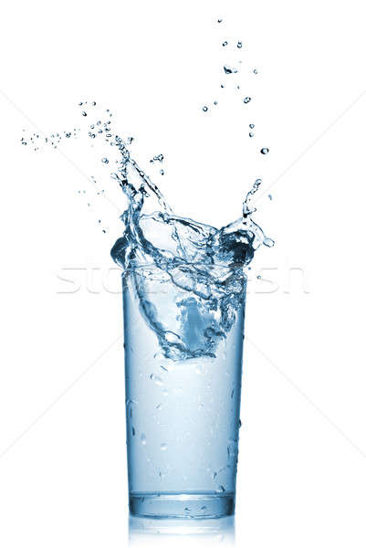 Stock photo: water splash in glass isolated on white