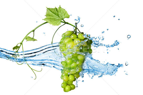Stock photo: green grape with water with splash isolated on white