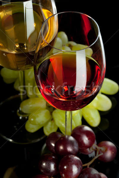 Red and white wine in glasses with grape. Top view