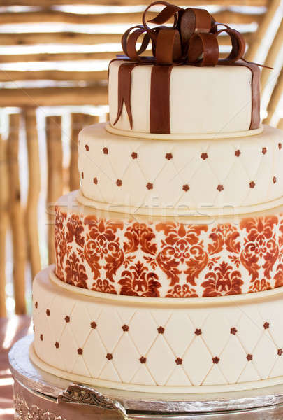 Stock photo: Layered white wedding cake with chocolate detail