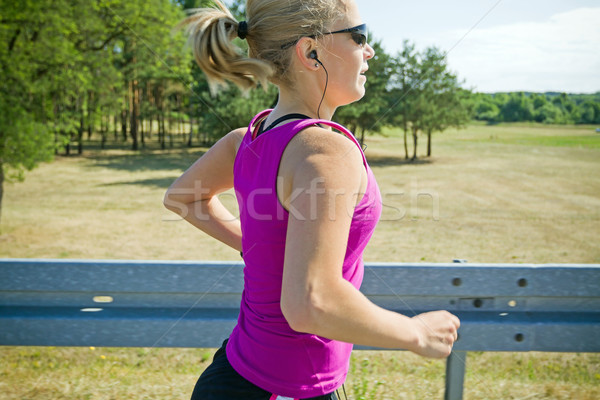 Stock photo: Running woman in summer, motion blur