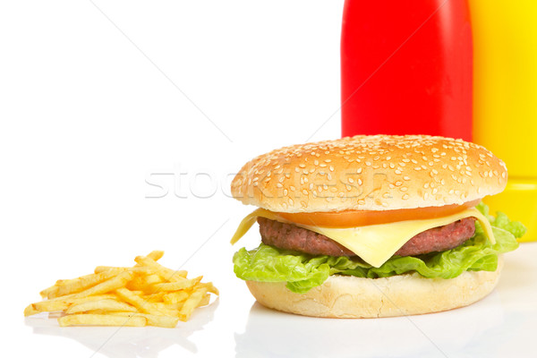 Stock photo: Cheeseburger, mustard, ketchup and french fries