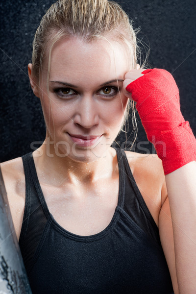 Stock photo: Boxing training blond woman sparring punching bag
