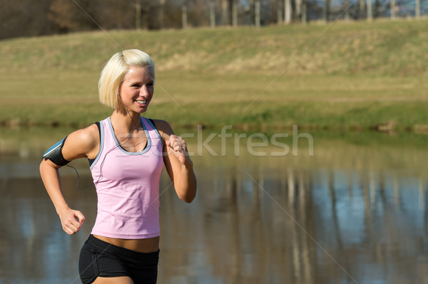 Stock photo: Young woman jogging lake park sunny day