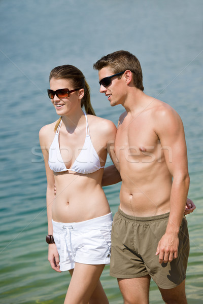 Stock photo: Happy couple in swimwear walk in lake