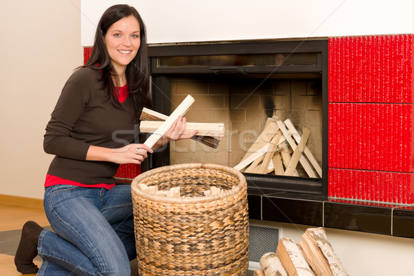 Stock photo: Home fireplace woman put logs happy winter