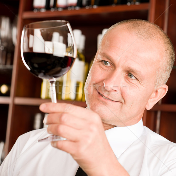 Stock photo: Wine bar waiter looking at glass restaurant