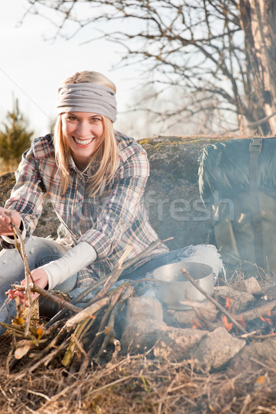 Stock photo: Hiking woman with backpack cook by campfire