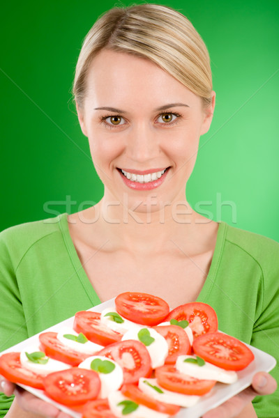 Stock photo: Healthy lifestyle - woman with caprese salad