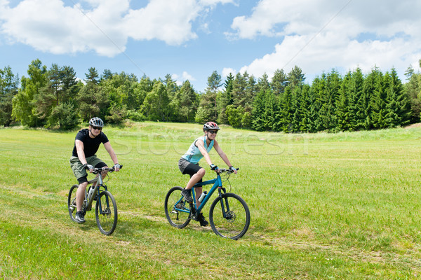 Stock photo: Sport happy couple riding bicycles in coutryside
