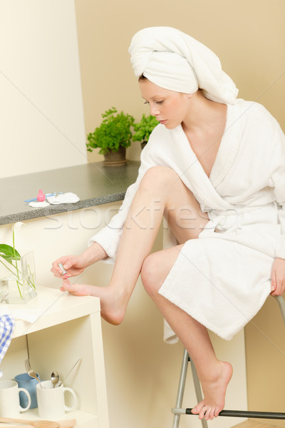 Stock photo: Young student girl polishing her toe nails