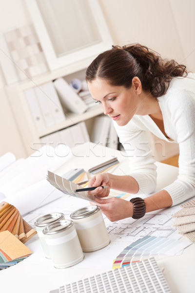 Stock photo: Young female interior designer at office with paint
