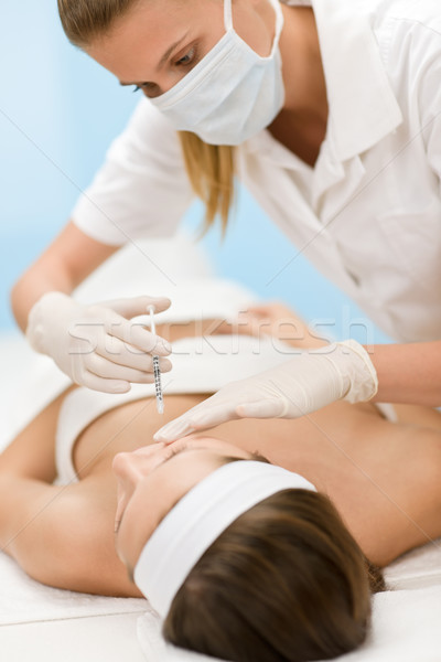 Stock photo: Botox injection - Woman in cosmetic medicine treatment
