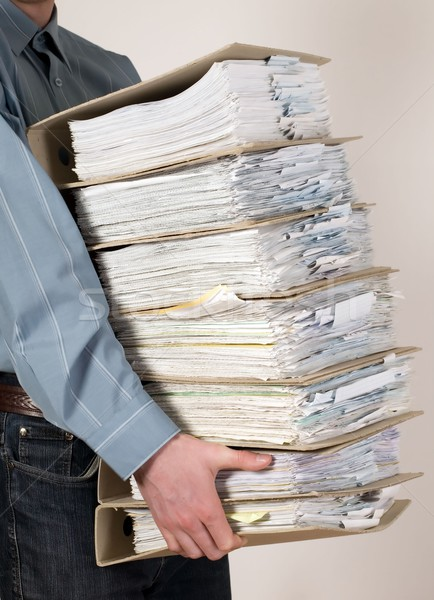 Stock photo: Man holding catalog of documents