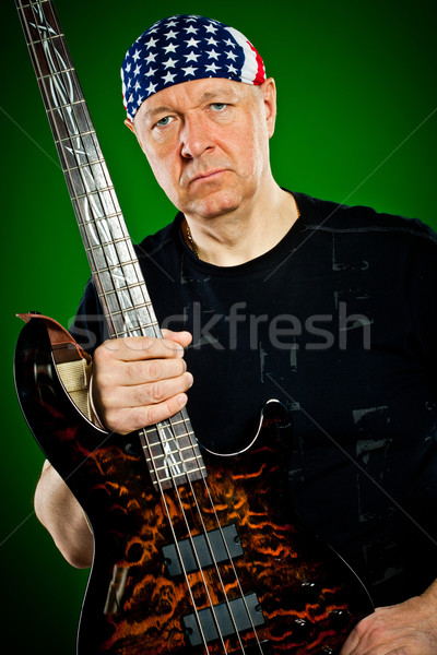 Stock photo: man with a guitar, bass player