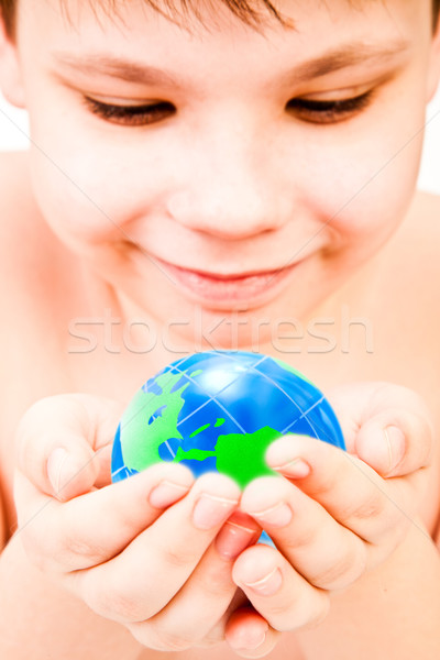 Stock photo: boy holds globe in hands