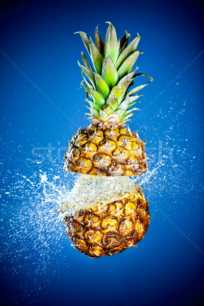 Stock photo: Pineapple splashed with water