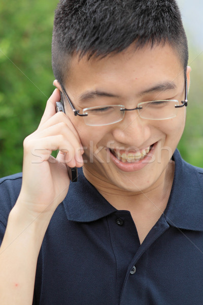 Stock photo: asia man talking on phone