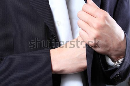Stock photo: businessman hand in  pocket of a jacket