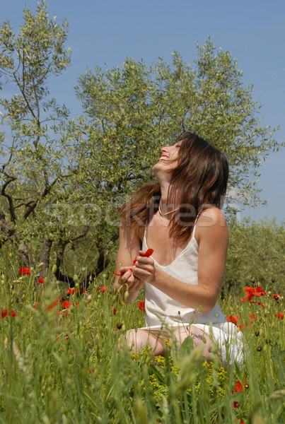Stock photo: laughing woman in field