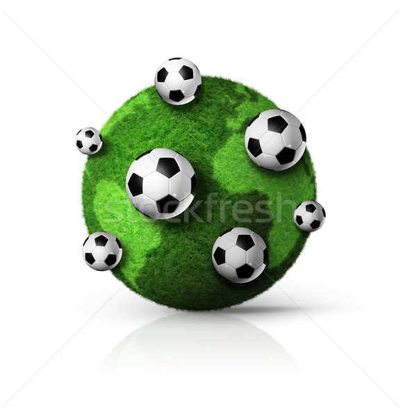 Stock photo: green grass world globe with soccer balls