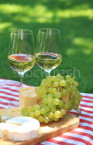 Stock photo: Various sorts of cheese with white wine