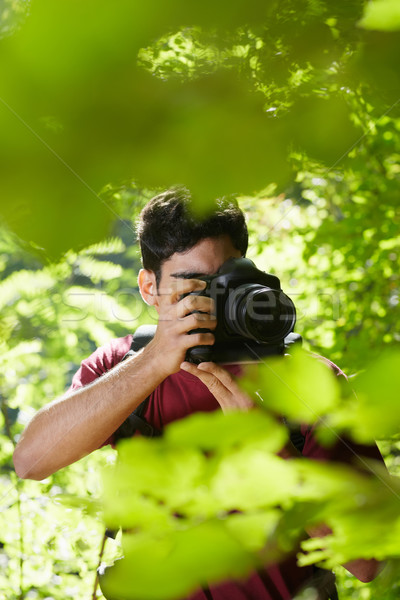 Stock photo: young male photographer hiking in forest