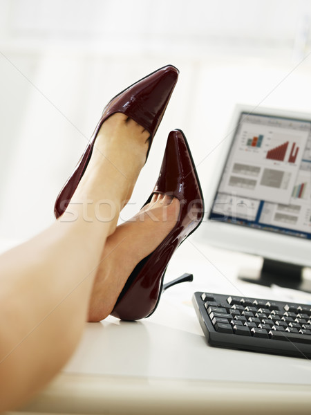 Model Business Woman Taking Off Shoes In Office Copy Space  Stock Photo