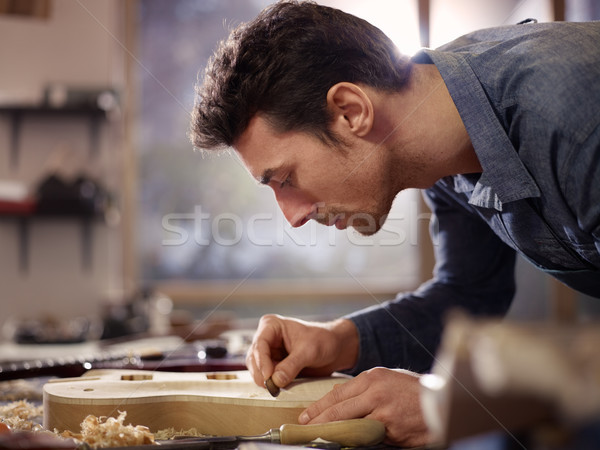 Stock photo: italian artisan working in lutemaker workshop