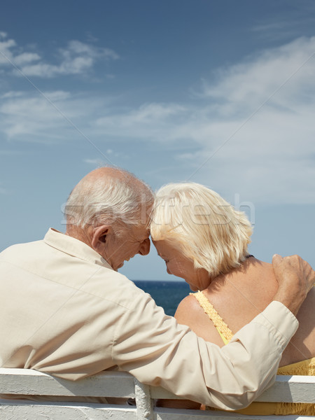 Stock photo: old man and woman on bench at the sea