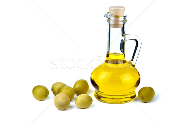 Stock photo: Small decanter with olive oil and some olives near