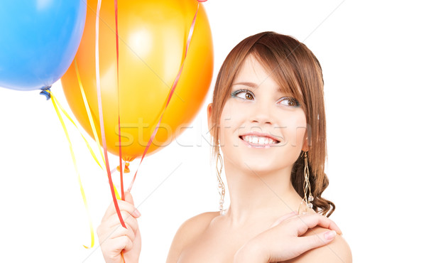 Stock photo: happy teenage girl with balloons