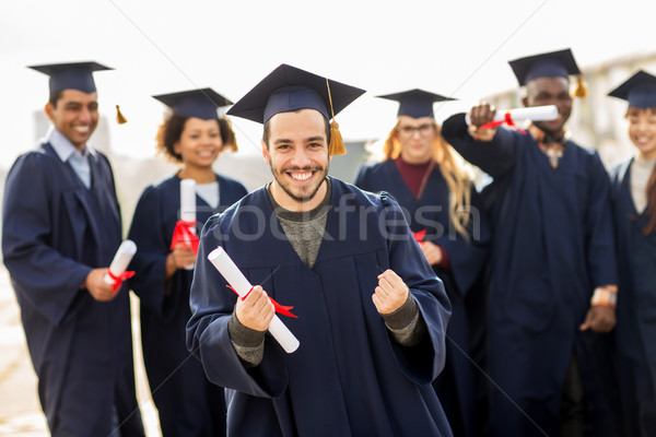 Stock photo: happy student with diploma celebrating graduation