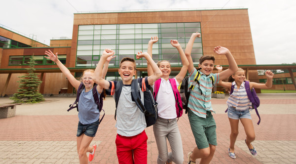 Stock photo: group of happy elementary school students running