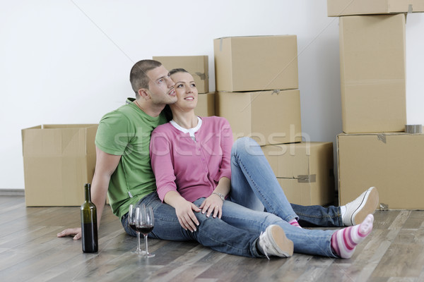 Stock photo: Young couple moving in new home