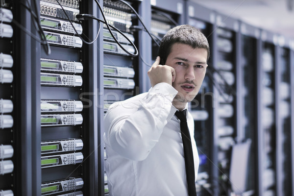 Stock photo: it engeneer talking by phone at network room