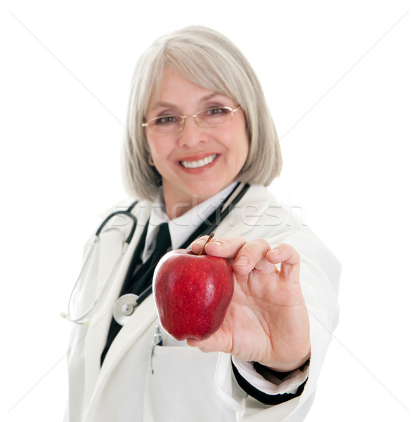 Stock photo: Mature female doctor holding an apple